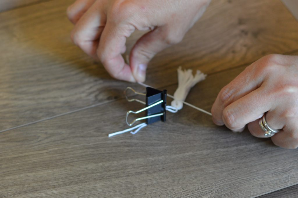 Binder clip holding floss